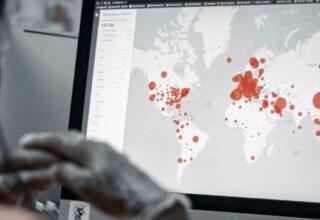 Scientist looking at screen of disease outbreak
